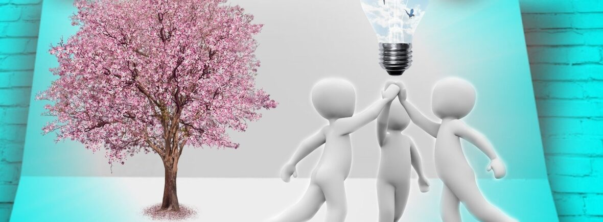 3 individuals holding lightbulb together
